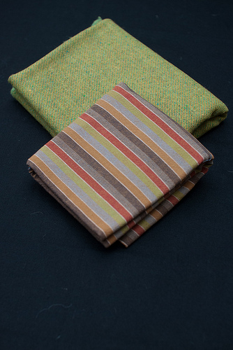 Green tweed and striped fabric